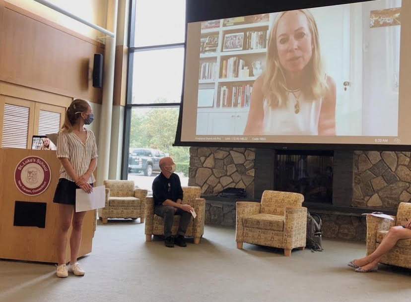 Cessa Lewis '23 and Mr. Vehslage listen to guest speaker Lisa Frelinghuysen at the Feminism Club's panel on September 29th.