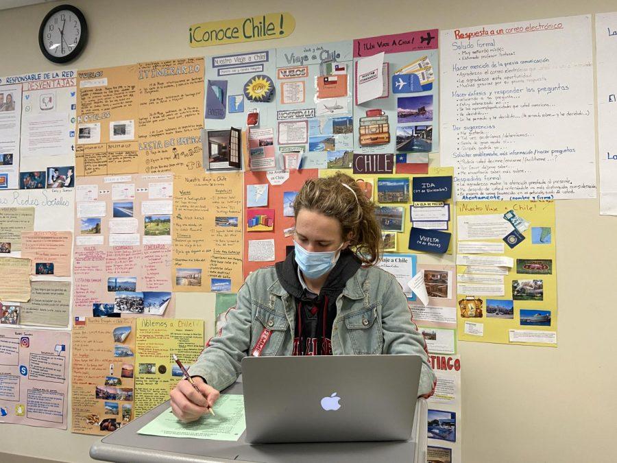 Ryan Sherman '21 working in a Spanish classroom. Photo by Molly Kim '21.